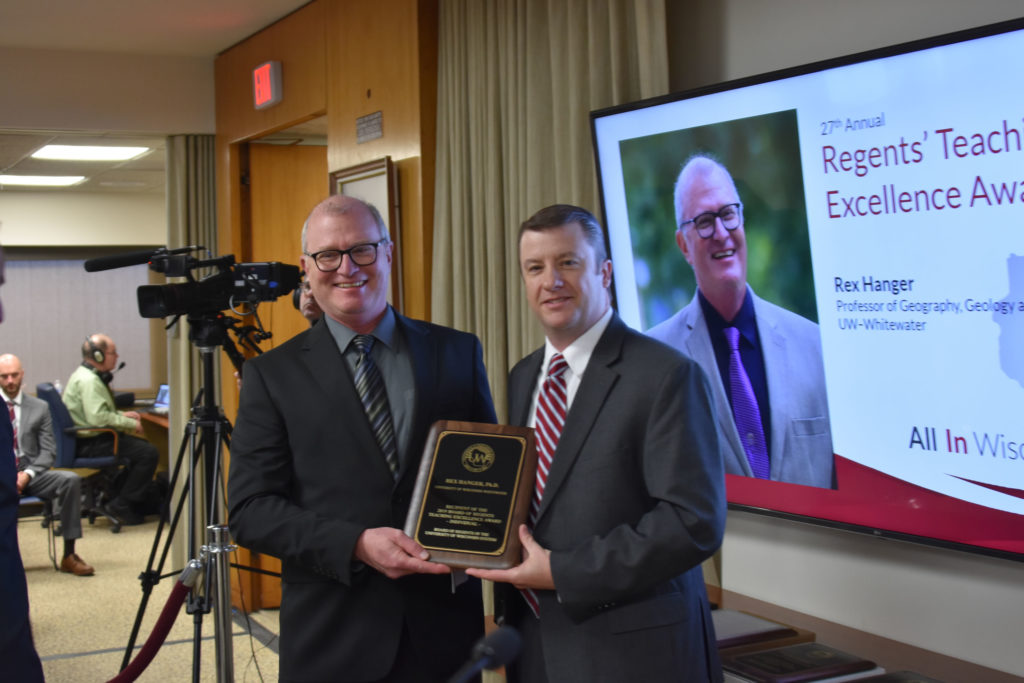 Photo of Professor Rex Hanger (left) from UW-Whitewater receiving a UW System Board of Regents 2019 Teaching Excellence Award from Regent Jason Plante at the Board of Regents meeting held in Madison on April 5, 2019.