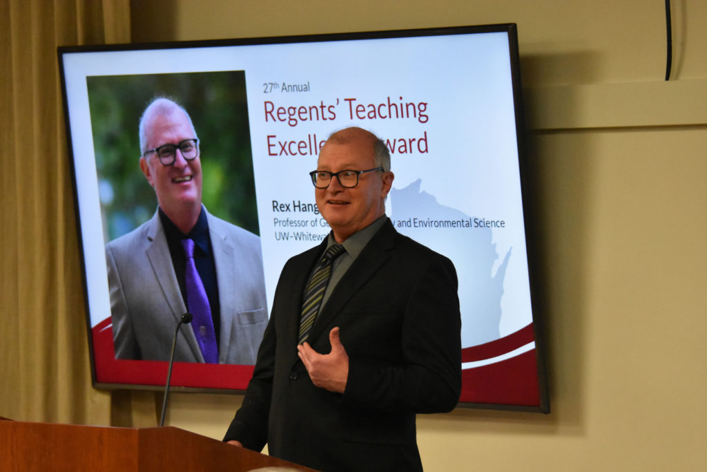 Photo of UW-Whitewater Professor Rex Hanger making acceptance remarks after receiving the 2019 Teaching Excellence Award from the UW System Board of Regents on April 5, 2019.