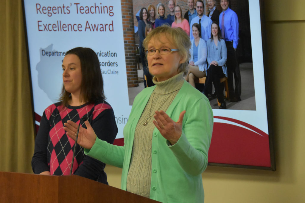 Photo of Department chair Dr. Vicki Samelson making acceptance remarks on behalf of UW-Eau Claire's Department of Communication Sciences and Disorders, which received a UW System Board of Regents 2019 Teaching Excellence Award on April 5, 2019. Also pictured: Associate Professor Abby Hemmerich.