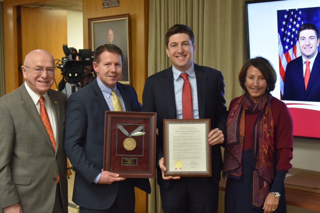 Photo of Regent Emeritus Bryan Steil (second from right), who received a resolution of appreciation for his service on the UW System Board of Regents. Also pictured (from left): UW System President Ray Cross, Regent President John Robert Behling, and Regent Tracey Klein.