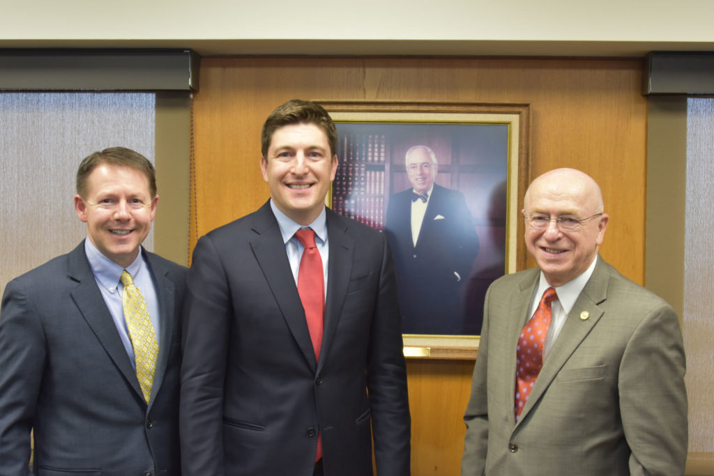 Photo of (from left) Regent President John Robert Behling; Regent Emeritus Bryan Steil; portrait of Regent Steil's grandfather, George K. Steil Sr., who served on the Board of Regents in the 1990s, including two years as Board president; and UW System President Ray Cross.