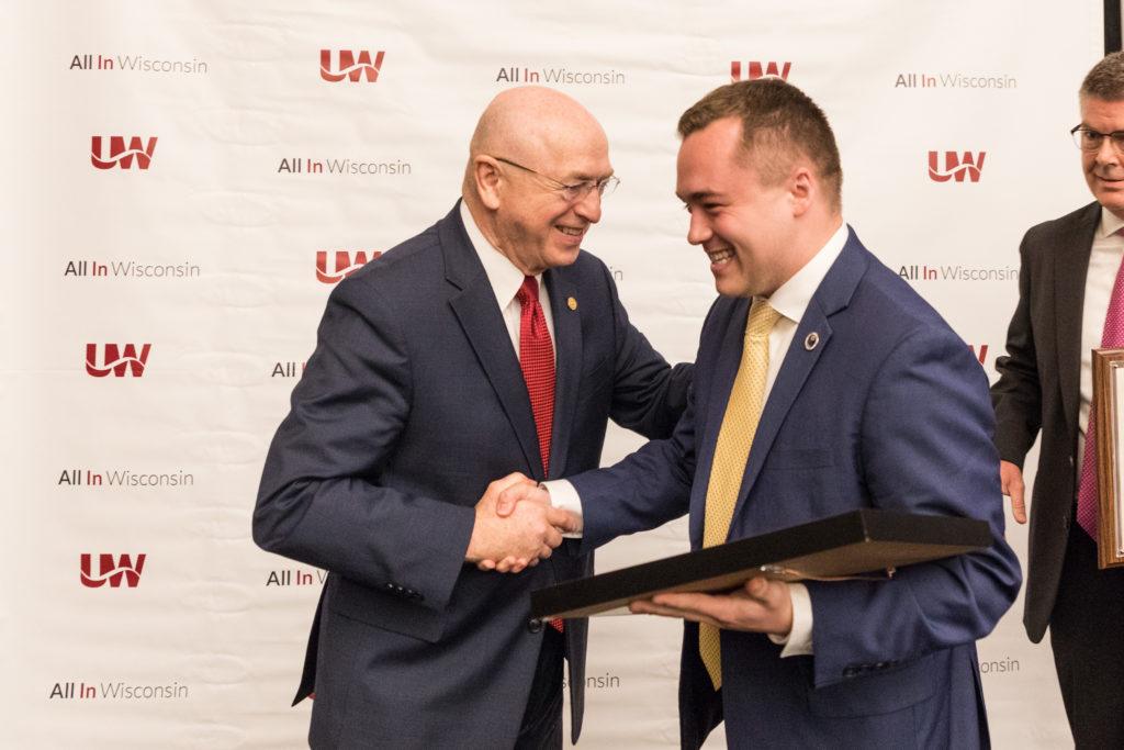 Photo of President Ray Cross congratulating Regent Emeritus Ryan Ring on his service