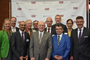 Photo of President Ray Cross, center, and Regent President Andrew S. Petersen, far right, welcoming a visiting delegation from the State of Hessen, Germany