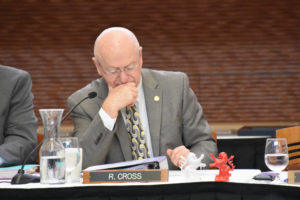 Photo of President Ray Cross with lion figurines, a gift from the Hessen delegation
