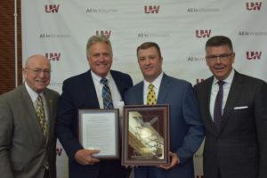 Photo of retiring UW-Stout Chancellor Robert Meyer, second from left, with President Ray Cross, Regent Jason Plante, and Regent President Andrew S. Petersen