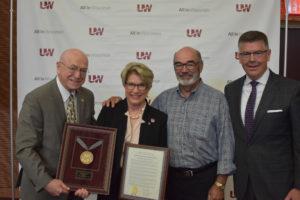 Photo of President Ray Cross, Regent Emerita Regina Millner receiving resolution of appreciation, Regent Emeritus Michael J. Falbo, and Regent President Andrews S. Petersen