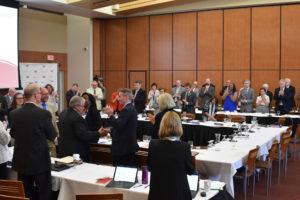 Photo of Regent Emeritus S. Mark Tyler greeting Regents