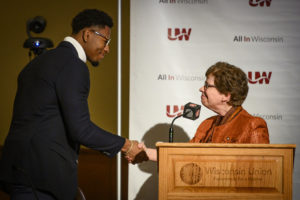 Photo of Kevin Crosby shaking hands with Chancellor Rebecca Blank