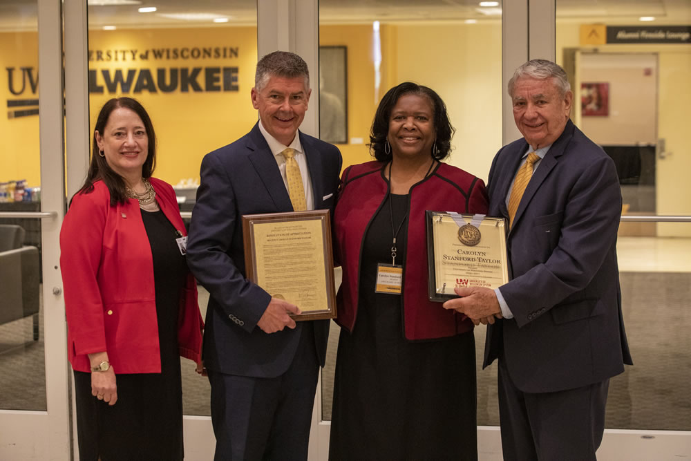 Photo of Regent Carolyn Stanford Taylor accepting her resolution of appreciation; (from left) Walsh, Petersen, Stanford Taylor, and Thompson