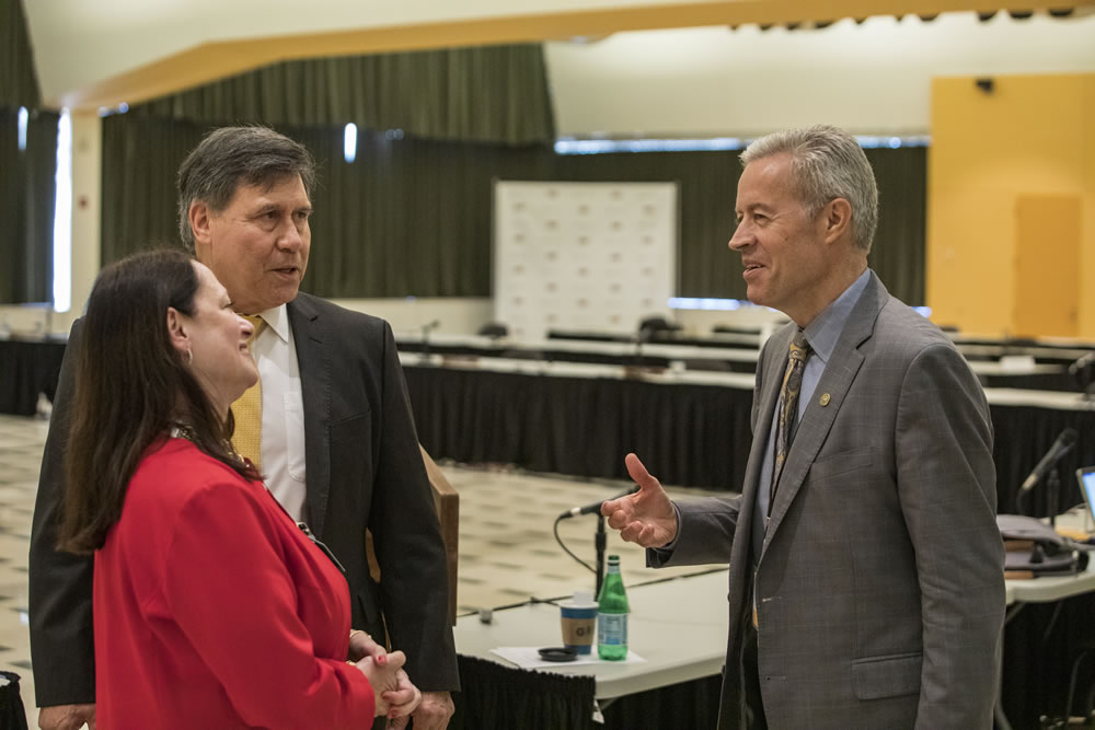 Photo of Regents Manydeeds and Walsh speaking with Chancellor Mone