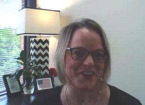 Photo of Denise Olstinske accepting Board of Regents 2020 Academic Staff Excellence Award