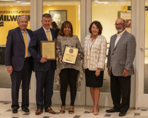 Photo of Regent Eve Hall accepting a resolution of appreciation (from left) President Thompson, Regent Petersen, Regent Hall, Regent Klein, and Regent Emeritus Falbo