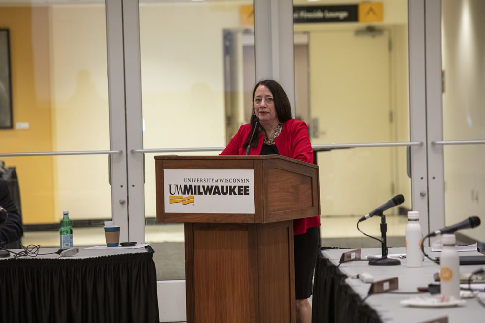 Photo of Regent Vice President Karen Walsh speaking at the podium