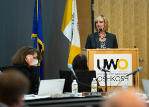 Photo of Monika Pynaker, UW-Green Bay, accepting University Staff Excellence Award