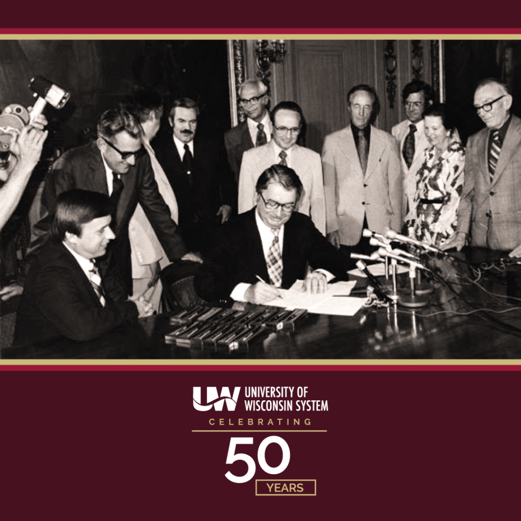 Photo of University of Wisconsin System signing in 1971; UW System celebrating 50 years in October 2021