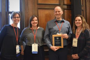 Wisconsin Teaching Fellows & Scholars 4 co-directors presenting a plaque to David Voelker, outgoing director.