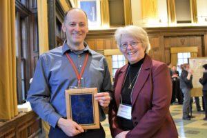 David Voelker, UWGB & Karen Schmitt AVP presenting service plaque