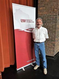 Bill Cerbin with UW banner