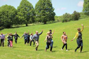 group running through grassy field
