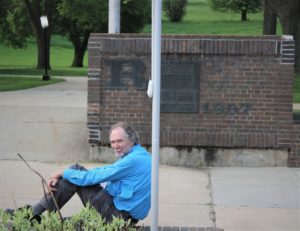 jim Robinson sitting outdoors