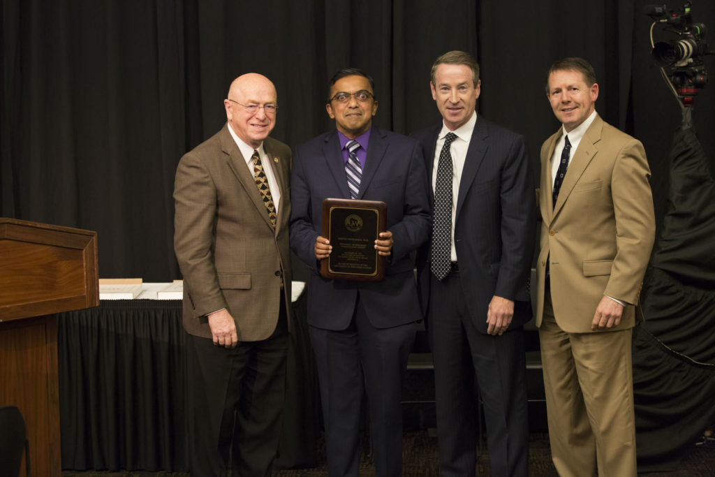 Photo of (from left) President Ray Cross, Dr. Kirthi Premadasa, Regent Mike Jones, and President John R. Behling