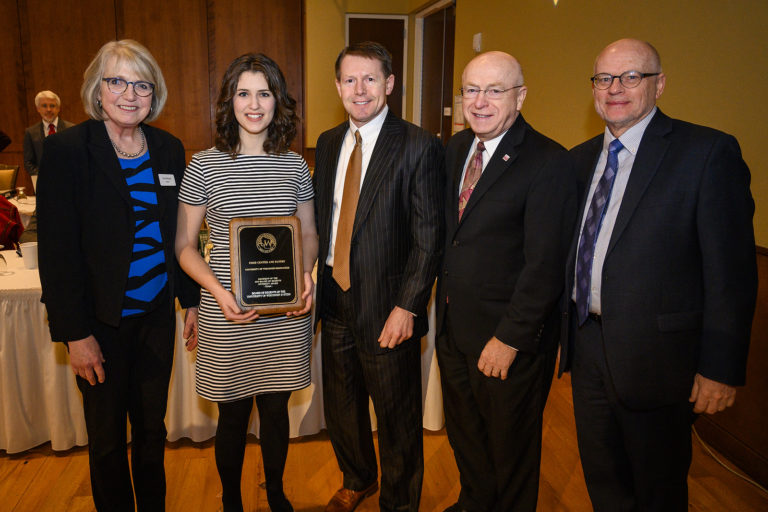 Photo of Quincy Kissack, assistant director of Student Associate Professional Staff at UW-Milwaukee, receiving a UW Board of Regents Diversity Award on behalf of the UW-M Food Center and Pantry at the UW System Board of Regents meeting hosted at Union South at the University of Wisconsin-Madison on Feb. 8, 2019. (Photo by Bryce Richter /UW-Madison)