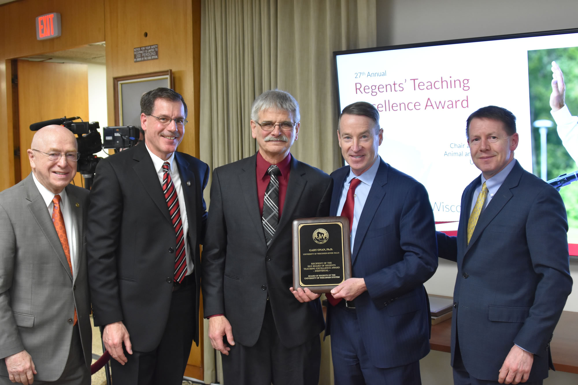 Photo of (from left) President Ray Cross, UW-River Falls Chancellor Dean Van Galen, Dr. Gary Onan, Regent Mike Jones, and Regent President John Robert Behling