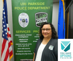 Photo of UW-Parkside Officer Kelly Andrichik, accepting the 2021 University Staff Excellence Award on behalf of the You Have Options Program