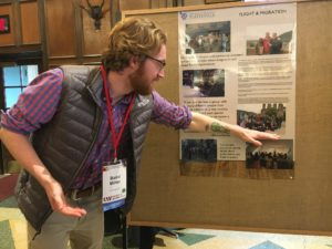 Student from UW-Platteville pointing to information on their poster