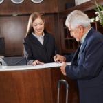 person checking into hotel