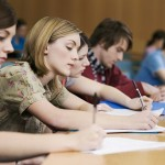 University students take notes in a lecture